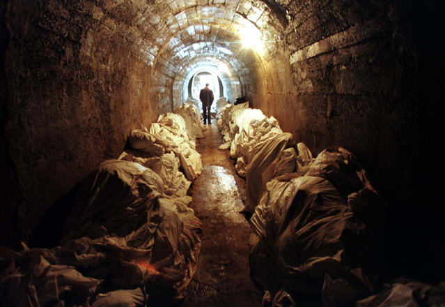 Stacks of unidentified corpses line the walls of an underground shelter at a Bosnian morgue in Tuzla, March 1997. The body bags contain victims found in mass graves and wooded areas in Srebrenica. Former Bosnian Serb leader Radovan Karadzic was found guilty of the 1995 Srebrenica genocide and nine other war crimes charges, U.N. judges said, sentencing him to 40 years in prison. (Photo by Reuters)