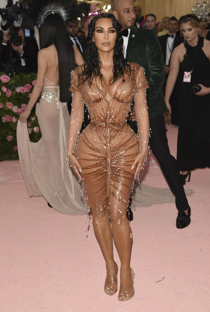 "Kim Kardashian attends The Metropolitan Museum of Art's Costume Institute benefit gala celebrating the opening of the ""Camp: Notes on Fashion"" exhibition on Monday, May 6, 2019, in New York. (Photo by Evan Agostini/Invision/AP Photo)"