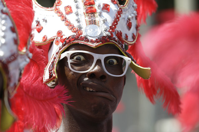 A performer reacts to the camera during the Lagos Carnival, Nigeria, Saturday May 9, 2015. Performers filled the streets of Lagos islands Saturday as part of the Lagos Carnival, a major festival in Nigeria's largest city. (Photo by Sunday Alamba/AP Photo)