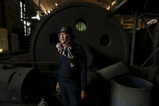 A worker stands while working inside a sugar mill at Pakchong district in Ratchaburi province, Thailand March 22, 2016. (Photo by Jorge Silva/Reuters)