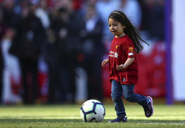 Makka, age 5, the daughter of Liverpool's Mohamed Salah, not pictured, kicks the ball at the end of the English Premier League soccer match between Liverpool and Wolverhampton Wanderers at the Anfield stadium in Liverpool, England, Sunday, May 12, 2019. Despite a 2-0 win over Wolverhampton Wanderers, Liverpool missed out on becoming English champion for the first time since 1990 because title rival Manchester City beat Brighton 4-1. (Photo by Dave Thompson/AP Photo)