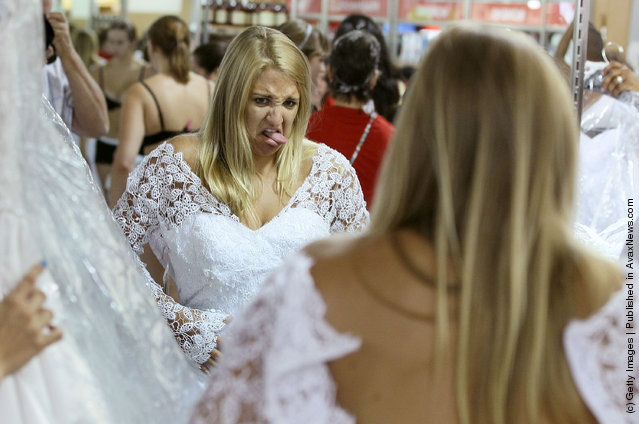 Bride to be Lauren Cechak expresses her dislike for a wedding gown after trying it on during Filene's Basement's annual sale