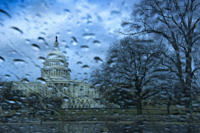 A band of rain showers move over the U.S. Capitol in Washington, DC  on March 12, 2014. High's today reached the lower 70's  and dropped 20 degrees by midnight in the District as rain moved into the area.   Tomorrow's high is expected to be 36 degrees. (Photo by Linda Davidson/The Washington Post)