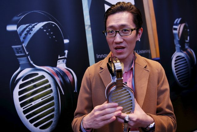 Chinese headphone company Hifiman's Ricardo Yeh speaks about his product during the CanJam headphone and personal audio expo in Singapore February 21, 2016. (Photo by Edgar Su/Reuters)