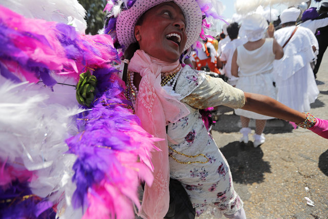 """Jennifer Jones dances in a jazz funeral procession for Leah Chase, as it goes from St. Peter Claver Church to her restaurant """"Dooky Chase's"""" in New Orleans, Monday, June 10, 2019. Fellow chefs, musicians, family and friends were among hundreds of admirers who filed through the church on Monday to pay last respects to Chase, the """"Queen of Creole Cuisine"""" who ran a family restaurant where civil rights strategies were discussed over gumbo and fried chicken in the 1950s and '60s. (Photo by Gerald Herbert/AP Photo)"""