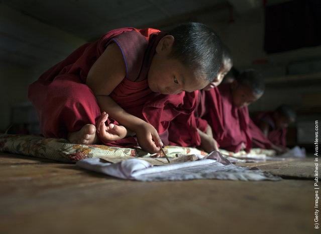 Sangey, 6, reads during class at the Dechen Phodrang monastery in Thimphu, Bhutan
