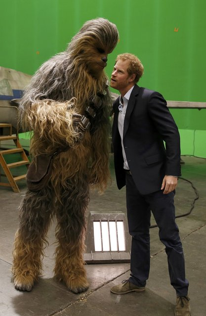 Britain's Prince Harry meets Chewbacca during a visit to the Star Wars film set at Pinewood Studios near Iver Heath, west of London, Britain, April 19, 2016. (Photo by Adrian Dennis/Reuters)