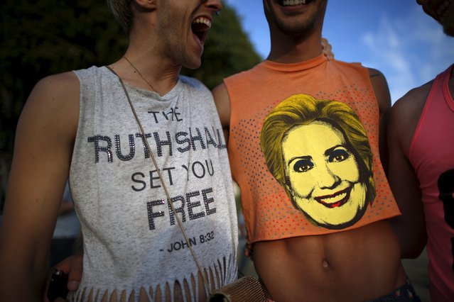 "A man wears a shirt saying ""The Ruth Shall Set You Free"", a reference to U.S. Supreme Court Justice Ruth Bader Ginsburg, as he stands next to a man with a Hillary Clinton shirt at a celebration rally in West Hollywood, California, United States, June 26, 2015. (Photo by Lucy Nicholson/Reuters)"