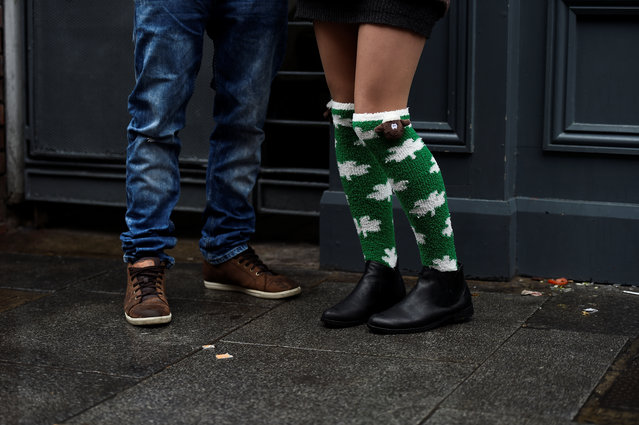 A woman wearing shamrock socks is seen during the St. Patrick's day parade in Dublin, Ireland on March 17, 2017. (Photo by Clodagh Kilcoyne/Reuters)