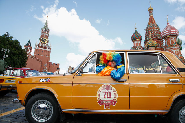 A vintage car before the 2019 GUM Motor Rally featuring classic cars in Moscow, Russia on July 28, 2019. The GUM AutoRally has been held annually since 2014 and is the largest and most important retro car competition in Russia. (Photo by Artyom Geodakyan/TASS via Getty Images)