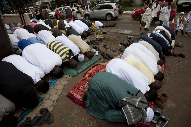 Kenyan Muslims pray outside Masjid As Salaam during the Eid al-Fitr prayers in Nairobi, Kenya, Tuesday, June 4, 2019. Muslims around the world celebrate the end of the holy month of Ramadan. (Photo by Sayyid Abdul Azim/AP Photo)