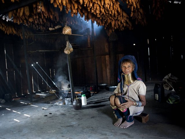 A Kayan woman sits in a smokehouse in Panpet village, Demoso township in Kayah state. (Photo by Ye Aung Thu/AFP Photo)