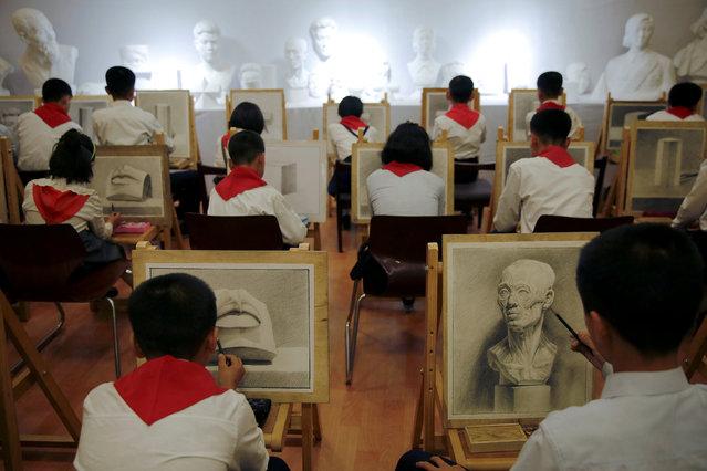 Students draw at the Mangyongdae Children's Palace in Pyongyang, North Korea May 5, 2016. (Photo by Damir Sagolj/Reuters)