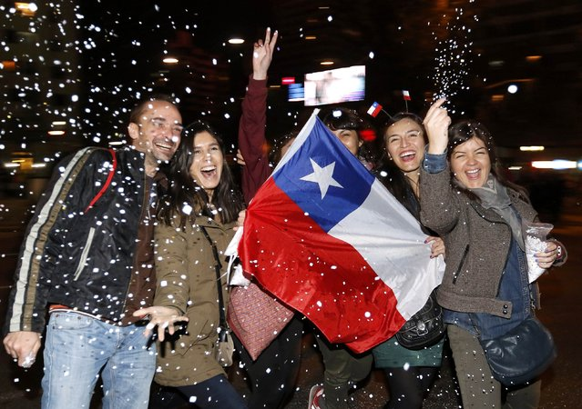 Chilean fans celebrate their team defeating Argentina to win the Copa America 2015 final soccer match at the National Stadium in Santiago, Chile, July 4, 2015. (Photo by Rodrigo Garrido/Reuters)