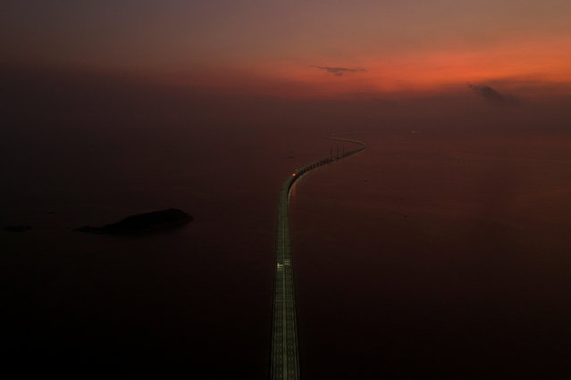An aerial view shows the Hong Kong-Zhuhai-Macau bridge, a key infrastructure in the Greater Bay Area project, during sunrise off Zhuhai, Guangdong province, China on September 12, 2019. (Photo by Reuters/China Stringer Network)