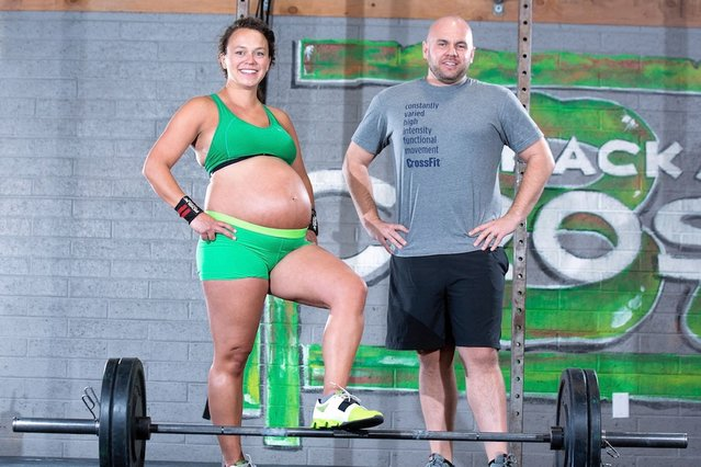 Meghan Umphres Leatherman, 9 months pregnant and dilated to 1cm poses with her husband Chad at her home town gym in Phoenix, Arizona. (Photo by Dave Cruz/Barcroft Media)