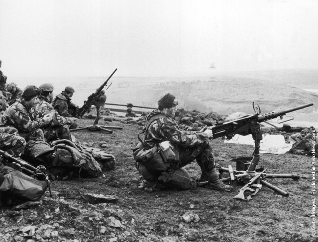1982:  British soldiers in action during the Falklands War