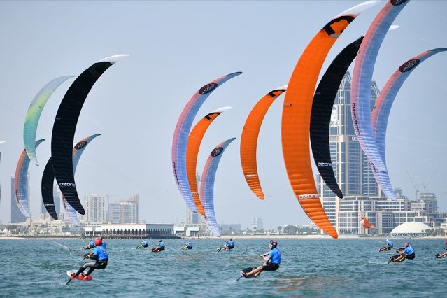 A handout picture provided by the Association of National Olympic Committees on October 13, 2019, shows competitors during a kitefoil race at Doha's Katara Beach, on the third day of the 1st ANOC World Beach Games. More than 1,500 athletes from 97 countries representing disciplines from beach volleyball to skateboarding, compete in Qatar during the World Beach Games which take place between October 11 and 16. (Photo by ANOC/AFP Photo)