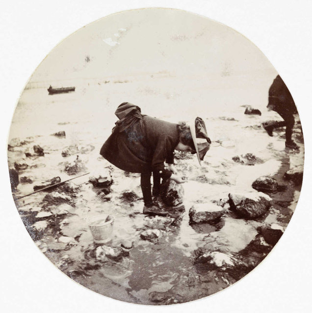 Girl looking in a rock pool, about 1890. (Photo by Collection of National Media Museum/Kodak Museum)