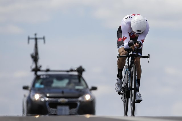 Canada's Hugo Houle pedals during the men's individual time trial cycling competition at the Pan Am Games in Milton, Ontario, Wednesday, July 22, 2015. Houle won the gold medal in the event. (Photo by Felipe Dana/AP Photo)