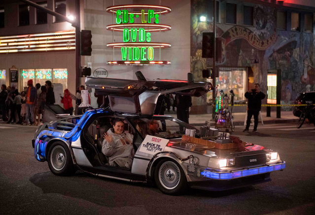 """The """"Back to the Future"""" movie car is driven down Sunset Blvd during the 88th annual Hollywood Christmas Parade in Hollywood, California on December 1, 2019. (Photo by Mark Ralston/AFP Photo)"""