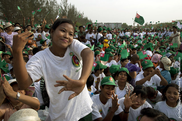 Burmese cheer at a rally with the government sponsored Union Solidarity and Development Party (USDP) by former military general, and General Secretary U Htay Oo ahead of the parliamentary elections