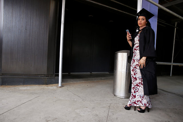 A graduate waits to line up for the Baruch College Commencement Exercise at the Barclay's Center in the Brooklyn borough of New York City, U.S., May 27, 2016. (Photo by Brendan McDermid/Reuters)