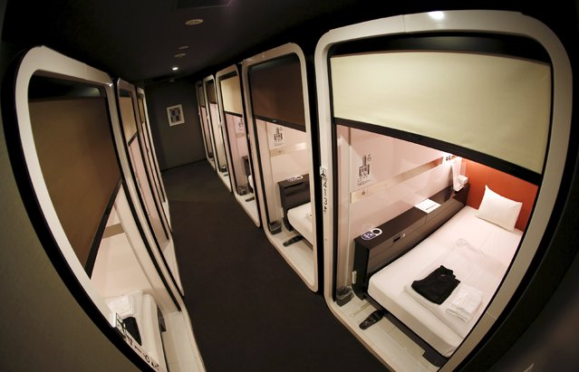 """Business-class"" cabins are seen at First Cabin hotel, which was converted from an old office building, in Tokyo, July 3, 2015. Record tourists to Japan are stretching the ability of hotels to accommodate them in a sector constrained by high costs, forcing developers to think out of the box for means to quickly increase lodging options without breaking the bank. (Photo by Toru Hanai/Reuters)"
