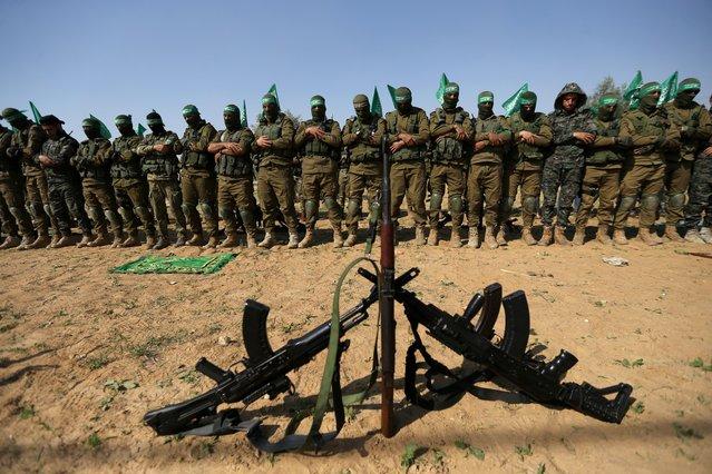 Palestinian Hamas militants pray during an anti-Israel military show in the southern Gaza Strip on November 11, 2019. (Photo by Ibraheem Abu Mustafa/Reuters)