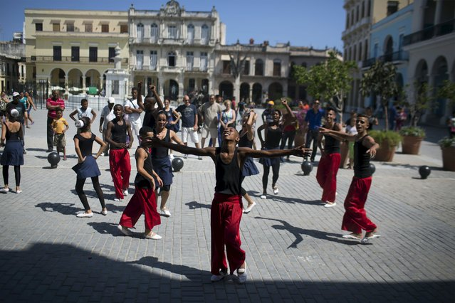 Children perform during the first day of a contemporary urban dance festival in downtown Havana, April 15, 2015. (Photo by Alexandre Meneghini/Reuters)