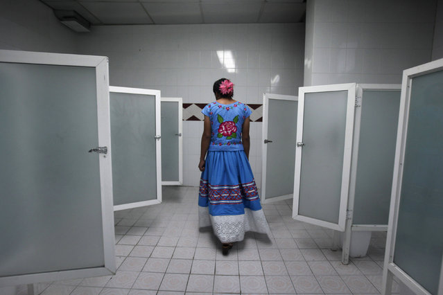 "Roberto, a man dressed as a traditional Zapotec also known as ""Muxe"", walks inside a women's bathroom during a traditional party in Mexico City, June 29, 2013. Anthropologists say the tradition of blurring genders among Mexico's indigenous population is centuries old but has been revived in recent decades due to the gay pride movement. The muxes, mostly of ethnic Zapotec descent, are widely respected in southern Mexico. (Photo by Edgard Garrido/Reuters)"