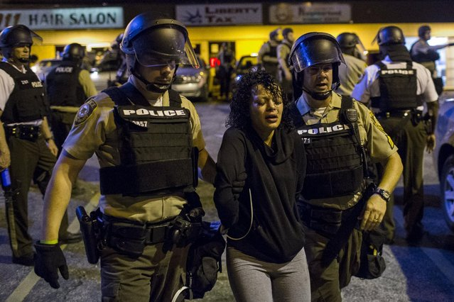 St Louis County police officers arrest an anti-police demonstrator in Ferguson, Missouri August 11, 2015. (Photo by Lucas Jackson/Reuters)