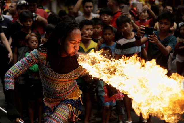 A performer blows fire during Chinese Lunar New Year celebrations in Chinatown, Binondo, Manila, Philippines, January 25, 2020. (Photo by Eloisa Lopez/Reuters)