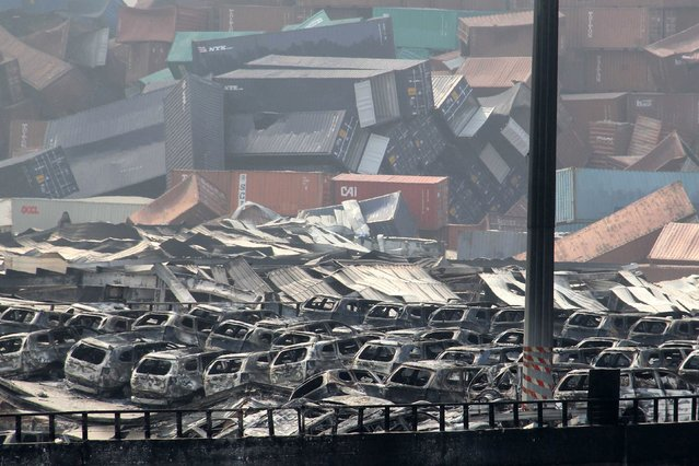 Damaged cars and containers are seen at the site of a series of explosions in Tianjin on August 13, 2015. (Photo by AFP Photo)