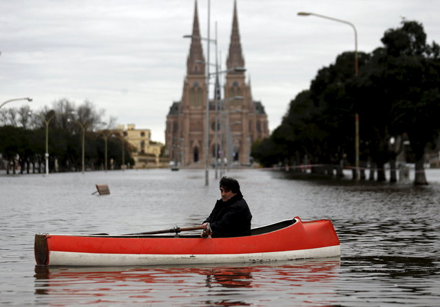 A man rows his boat in a flooded avenue in front of the Basilica of Lujan, Argentina, August 12, 2015. Over 20,000 people have been evacuated after torrential rains in the last weekend caused rivers to rise and flood cities in northern Buenos Aires province, local media reported. (Photo by Marcos Brindicci/Reuters)