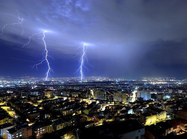 Lightnings brighten the sky over Ankara the Turkish capital. (Photo by Firat Yurdakul/Getty Images/Anadolu Agency)