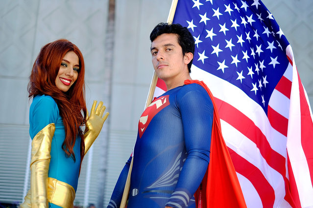 Belinda Sainz, left, and Bersain Gutierrez, both of San Diego, CA, portray the characters Phoenix and Superman during the 45th annual San Diego Comic-Con on July 24, 2014 in San Diego, California. (Photo by T. J. Kirkpatrick/Getty Images)