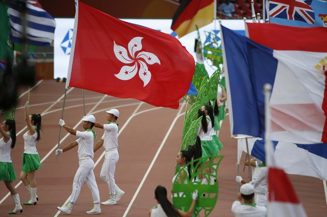 The Hong Kong flag is seen during the opening ceremony of the 15th IAAF World Championships at the National Stadium in Beijing, China August 22, 2015. (Photo by David Gray/Reuters)