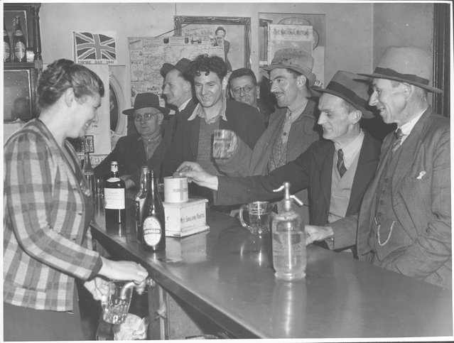 Mrs Gleeson pours a beer for a customer at the Drouin Hotel, Drouin, Victoria, 1944. Wife of Drouin publican (Mrs. James J. Gleeson) pours beer for customers. A pot like this (11oz.) costs 81/2 d. about half of which goes in excise to Australian government. Australian beer has 8% alcohol - heavier than American beer but about the same as British. Mrs Gleeson has two sons fighting the Jap; says she has never had a customer she could not handle in her 23 years at the Drouin Hotel