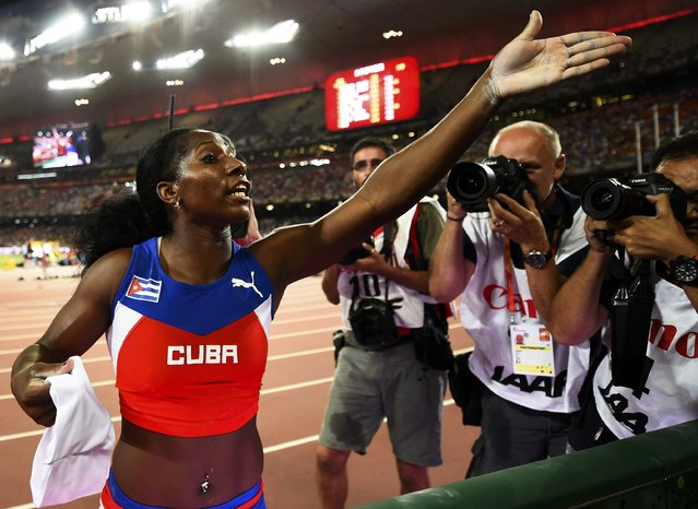 First placed Yarisley Silva of Cuba speaks to her coach (unseen) after the women's pole vault final at the 15th IAAF World Championships at the National Stadium in Beijing, China, August 26, 2015. (Photo by Dylan Martinez/Reuters)