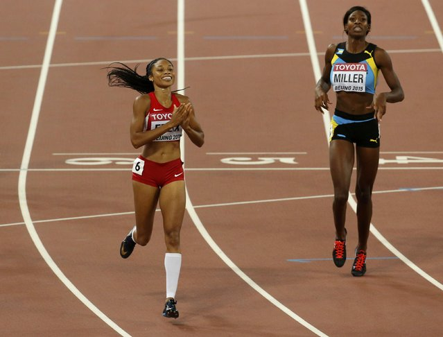 Allyson Felix of U.S. (L) celebrates winning the race ahead of Shaunae Miller of Bahamas in the women's 400 metres final during the 15th IAAF World Championships at the National Stadium in Beijing, China August 27, 2015. (Photo by Fabrizio Bensch/Reuters)
