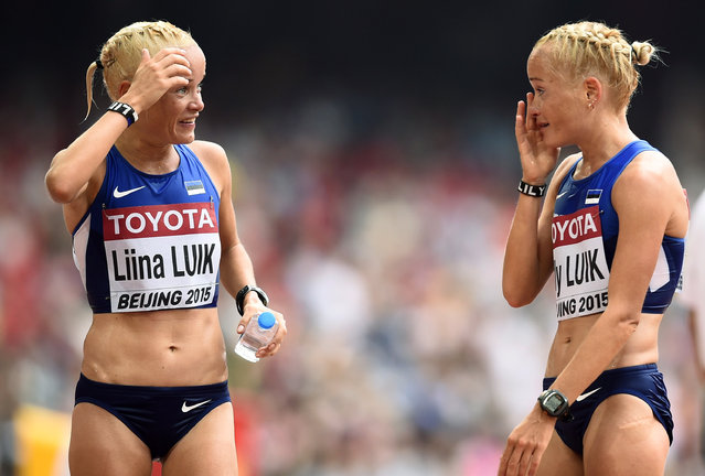 Liina Luik of Estonia (L) talks to compatriot Lily Luik after the women's marathon at the 15th IAAF Championships in Beijing, China August 30, 2015. (Photo by Dylan Martinez/Reuters)