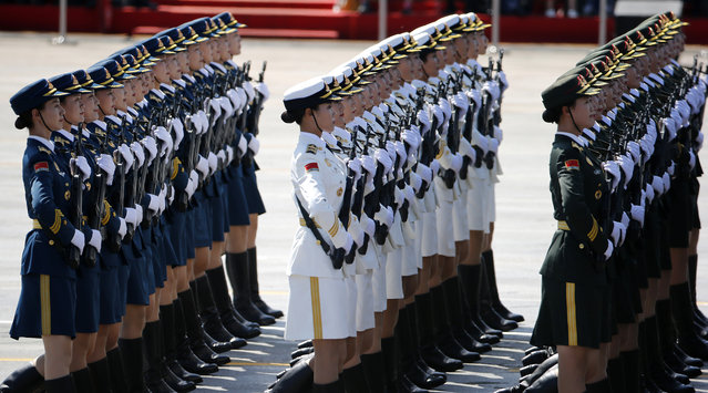 Chinese female military personnel march during a parade commemorating the 70th anniversary of Japan's surrender during World War II held in front of Tiananmen Gate, in Beijing, Thursday, SSeptember 3, 2015. (Photo by Ng Han Guan/AP Photo)