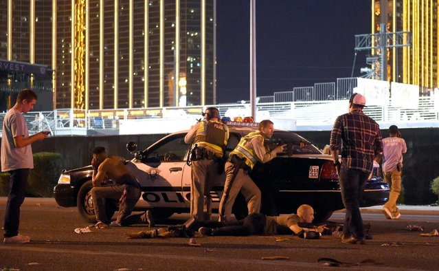 Las Vegas police stand guard along the streets outside the the Route 91 Harvest country music festival grounds after a active shooter was reported on October 1, 2017 in Las Vegas, Nevada. There are reports of an active shooter around the Mandalay Bay Resort and Casino. (Photo by David Becker/Getty Images)
