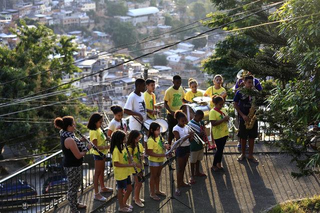 Members of Favela Brass band rehearse in Pereira da Silva favela, in Rio de Janeiro, Brazil, 01 August 2016. (Photo by Barbara Walton/EPA)