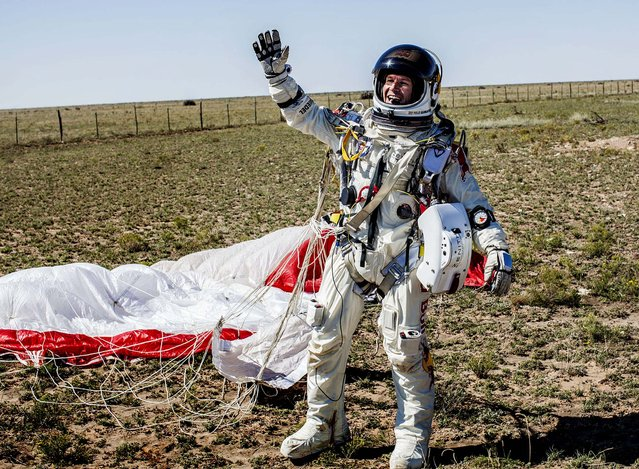 Baumgartner celebrates after successfully completing the jump. (Photo by Balazs Gardi/Red Bull Stratos)