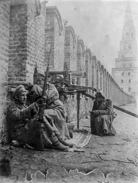 In this photo taken in October 1917, provided by Russian State Documentary Film and Photo Archive, junkers get ready at their position atop of the Kremlin Wall in Moscow, Russia. The 1917 Bolshevik Revolution was long before the digital revolution allowed anyone to instantly document events. But the clumsy cameras of the time still caught some images that capture the period's drama. (Photo by Russian State Documentary Film and Photo Archive via AP Photo)