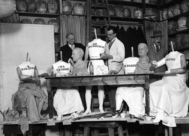 Craftsmen at the Madame Tussaud's workshop arrange headless wax figures of Wakatsuki, Stimson, MacDonald, Tardieu and Grandi into a tableau of a political conference. 20th February 1930. (Photo by Fox Photos)