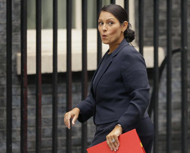 """In this Tuesday, October 10, 2017 file photo, Britain's Secretary of State for International Development Priti Patel reacts to a question from the media as she arrives for a cabinet meeting at 10 Downing Street in London. Running for election mere months ago, British Prime Minister Theresa May's slogan was """"strong and stable government"""". The phrase sounds cruelly ironic now, with several senior members of May's Cabinet under fire for missteps or under investigation for alleged sexual misconduct. The latest bad news came when it emerged this week that International Development Secretary Priti Patel held 12 meetings with Israeli groups and officials, including Prime Minister Benjamin Netanyahu, while she was on vacation in the country in August – and that she hadn't told the prime minister or colleagues about it. (Photo by Alastair Grant/AP Photo)"""
