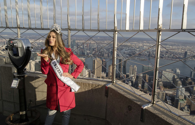 Miss Universe 2017 Demi-Leigh Nel-Peters, of South Africa, poses for photographers on the 86th Floor Observation Deck of the Empire State Building, Tuesday, November 28, 2017, in New York. (Photo by Mary Altaffer/AP Photo)